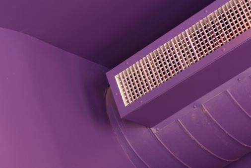 Air conditioner on purple walls